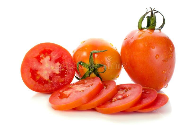 Glissière rouge de tomate avec la baisse de l'eau photographie stock