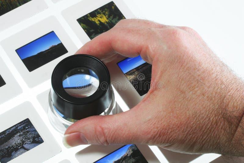Glissières sur le cadre léger avec la loupe photographie stock