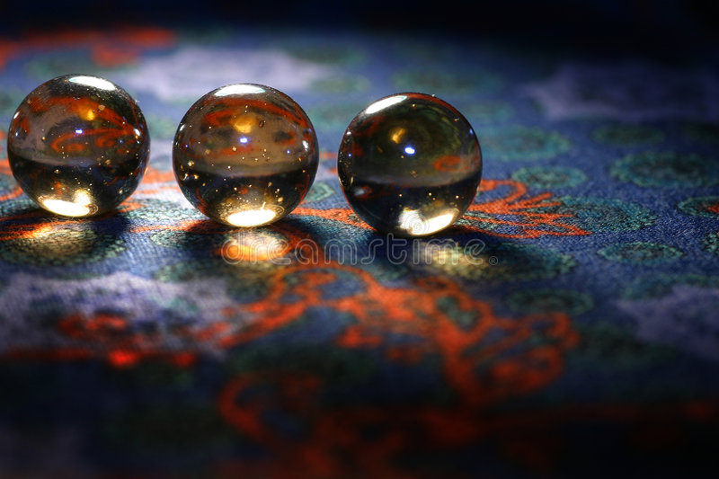 Glisten balls. A close-up of glisten balls on the pattern background royalty free stock image