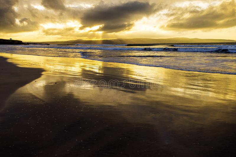 Wonderful golden evening by the sea in Cornwall, England stock photos