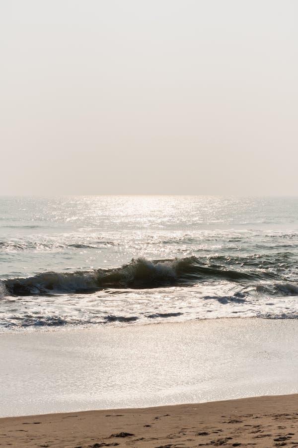 Glistening waves on beach royalty free stock photos