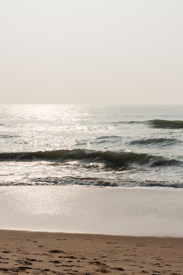 Glistening waves on beach royalty free stock photography