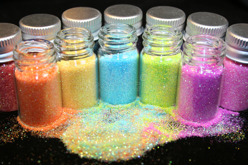 Glitter. An assortment of colorful glitter royalty free stock photography