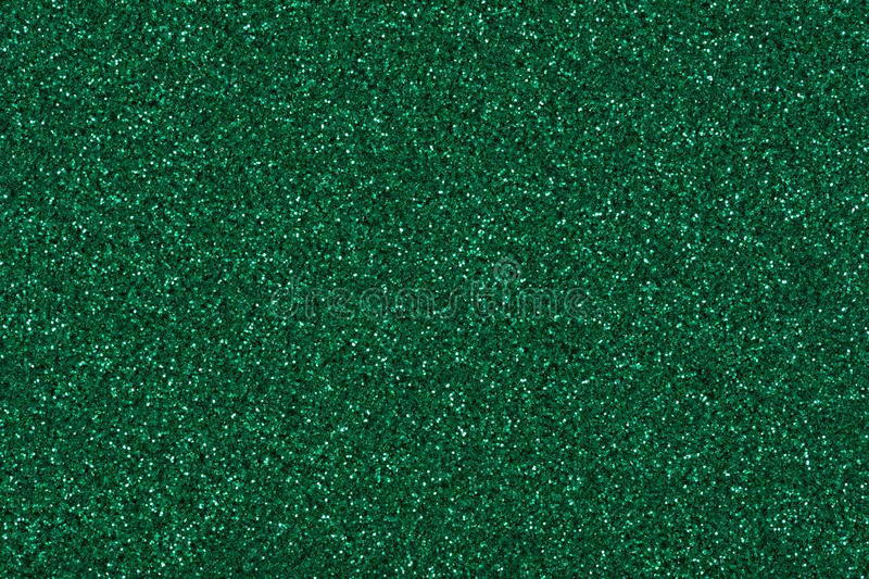 Glitter background in new green tone, shiny texture for your christmas desktop. stock images
