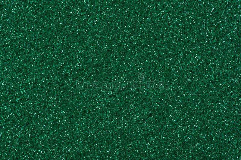 Glitter background for your stylish christmas desktop, texture in admirable green colour. royalty free stock images