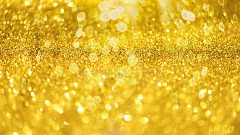 Glitter defocused abstract background with blurry lights, stars. Christmas festive texture. New year party stock image