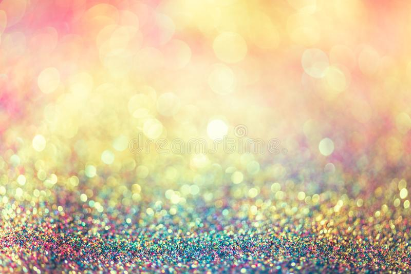 Glitter gold bokeh Colorfull Blurred abstract background for birthday, anniversary, wedding, new year eve or Christmas.  royalty free stock image