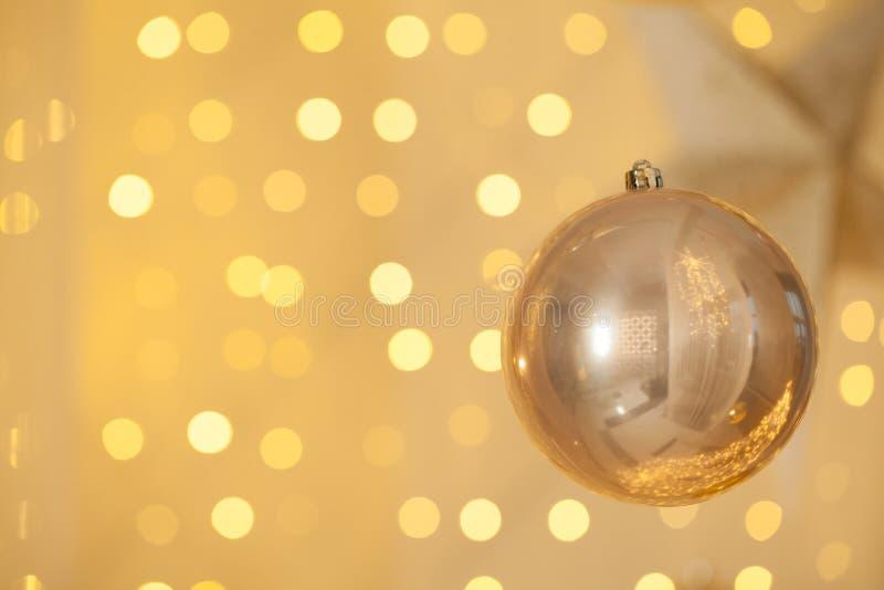 Glitter golden decor on gold bokeh glitter sparkle warm light background stock photos