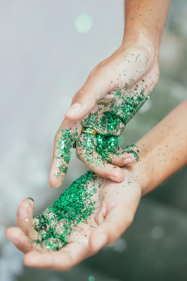 Glitter on hands stock photo