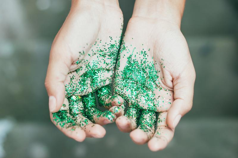 Glitter on hands stock images