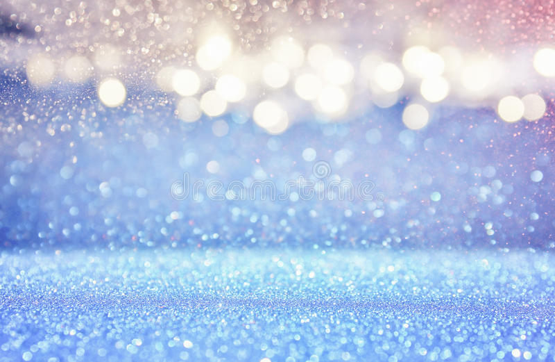Glitter light blue and silver lights background. Defocused stock photo
