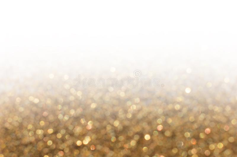 Glitter lights gold gradient blur background. Colorful bokeh tex stock photography