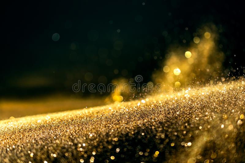 Glitter lights grunge background, gold glitter defocused abstract Twinkly Lights Background. royalty free stock photography