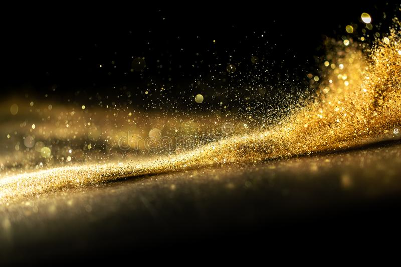 Glitter lights grunge background, gold glitter defocused abstract Twinkly Lights Background. stock photography