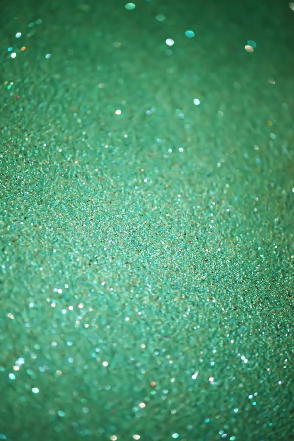 Glitter paper background. Festive sparkle texture. Decorative element for party, birthday, New Year design. Glitter paper colorful background. Festive sparkle royalty free stock image