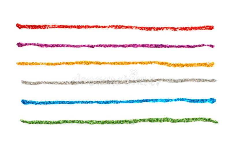 Glitter stelnar kulöra slaglängder royaltyfria foton