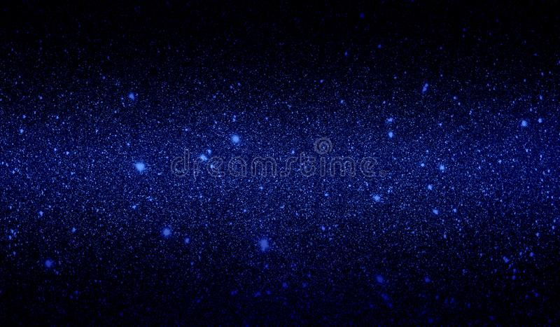 Glitter textured dark blue and black shaded background wallpaper. royalty free stock photography