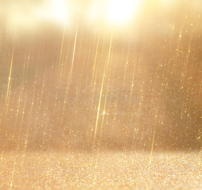 Glitter vintage lights background. abstract gold background . defocused royalty free stock image