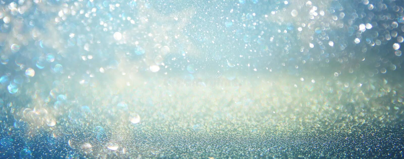 Glitter vintage lights background. blue, silver. defocused.  stock photo