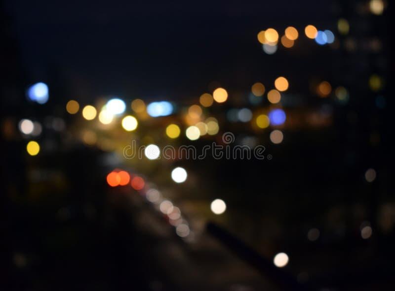 glitter vintage lights background. dark gold and black. defocused royalty free stock images