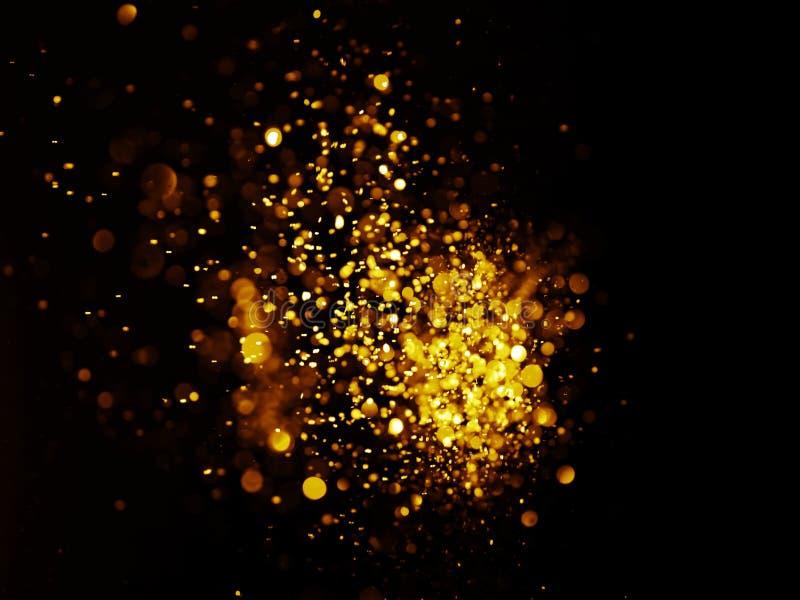 Glitter vintage lights background. dark gold and black stock images