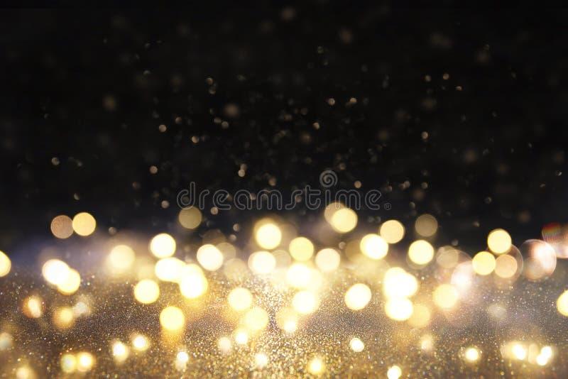 glitter vintage lights background. gold and black. defocused royalty free stock photo