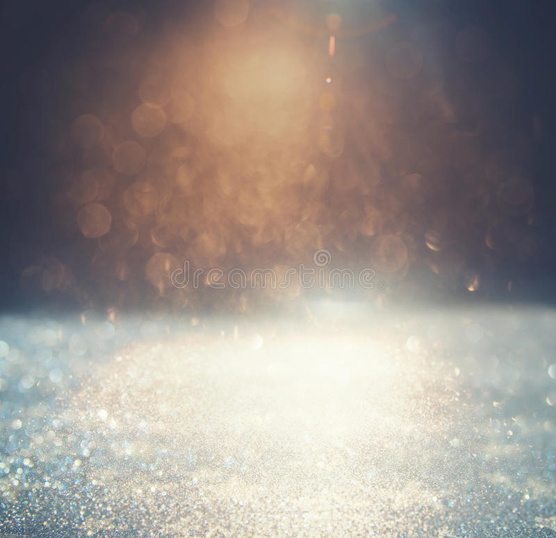 Glitter vintage lights background. gold, silver and black. defoc. Used stock photography
