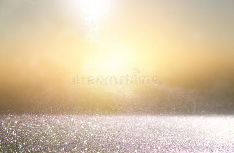 Glitter vintage lights background. gold, silver and black. defoc. Used royalty free stock photo
