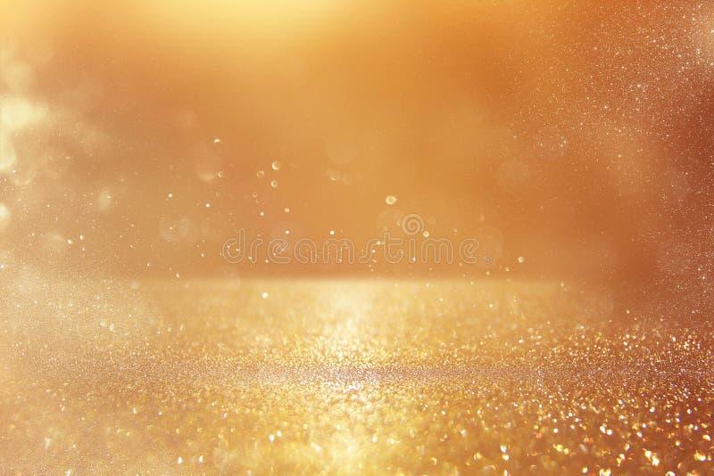 Glitter vintage lights background. gold and silver. De-focused stock images