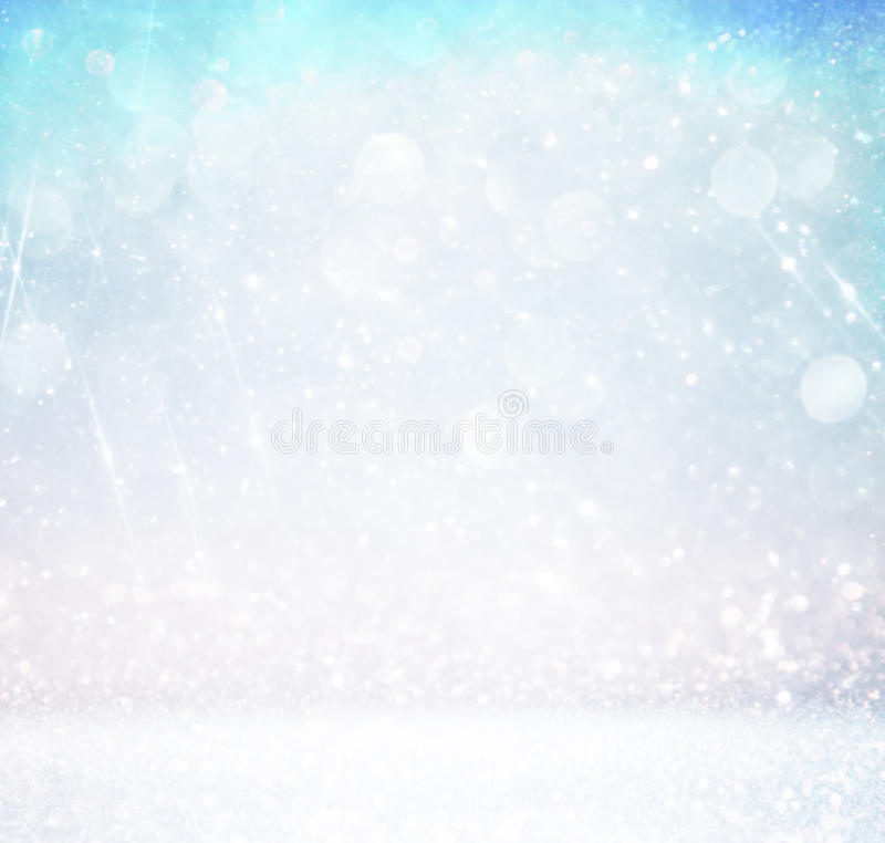 Glitter vintage lights background with light burst . silver, blue and white. de-focused. Glitter vintage lights background with light burst . silver, blue and vector illustration