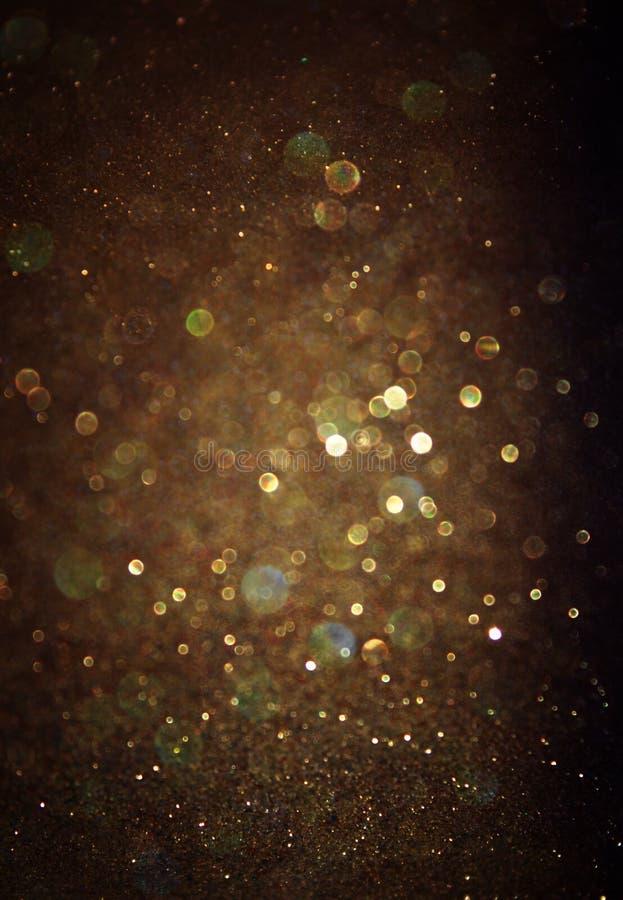Glitter vintage lights background. light gold and black. defocused stock images