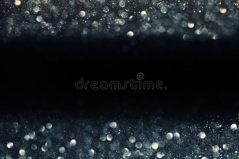 Glitter vintage lights background. light silver and black. defocused.  royalty free stock photography