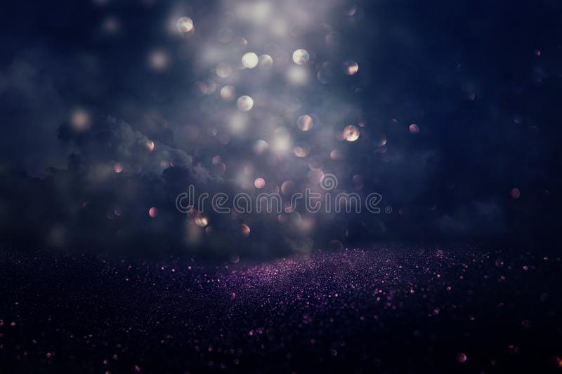Glitter vintage lights background. silver, black, purple and gold. de-focused. Abstract bling blurred blurry boke bokeh bright christmas cosmic design diamond royalty free stock photography