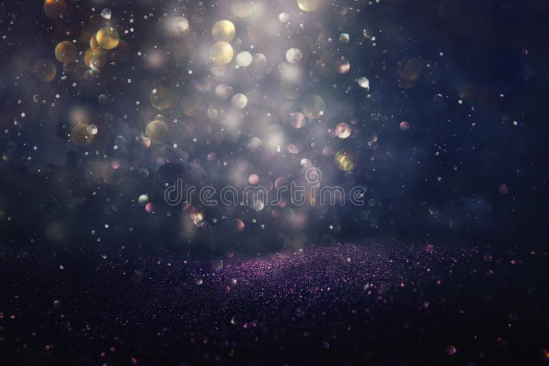 Glitter vintage lights background. silver, black, purple and gold. de-focused. Abstract bling blurred blurry boke bokeh bright christmas cosmic design diamond stock image