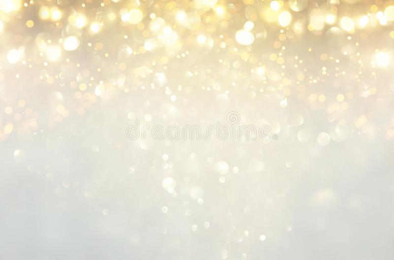 glitter vintage lights background. silver, gold and white. de-focused. royalty free stock photography