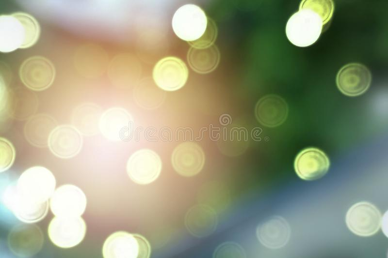 Glittering bokeh circular white on green background. Glittering bokeh circular white on green background empty space for text royalty free stock photo