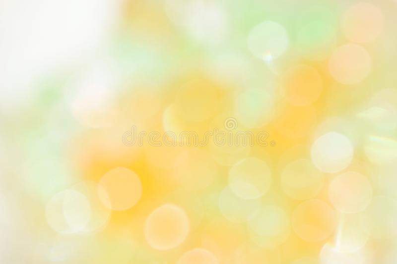 Glittering bokeh circular white on orange background and empty space for text . royalty free stock image