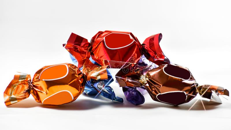 Glittering candy copy space on white background royalty free stock image