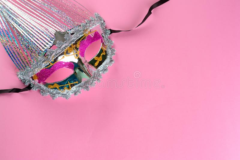 Glittering carnival mask on pink background. stock images