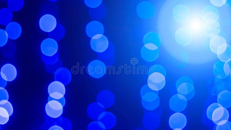 Glittering stars on bokeh with a highlight. Christmas background royalty free stock images