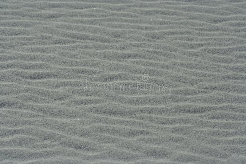 Sand wave pattern on the sand dunes at White Sands National Park, New Mexico, won. Glittering white sand dunes at White Sands National Park in New Mexico are stock photo