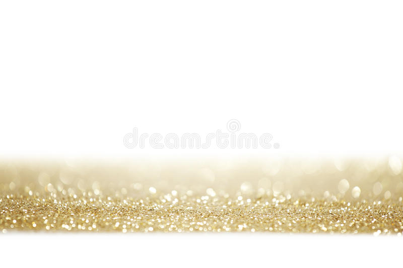 Glitters on white. Holiday golden glitters isolated on white background royalty free stock photo