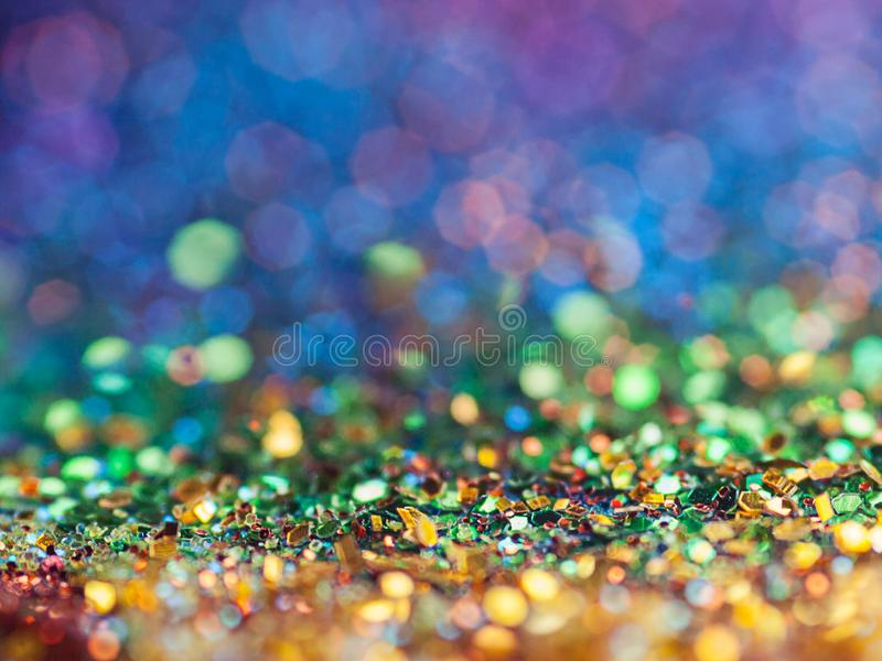 Glittery радуга Bokeh предпосылки искры стоковое фото