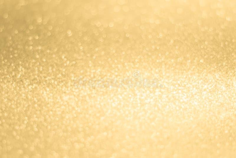 Glittery błyszczących świateł złocisty abstrakcjonistyczny tło obraz royalty free