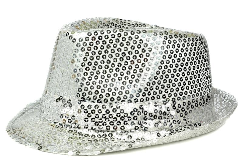 A silver sequin party hat. A glittery silver sequin party hat on white background royalty free stock photo