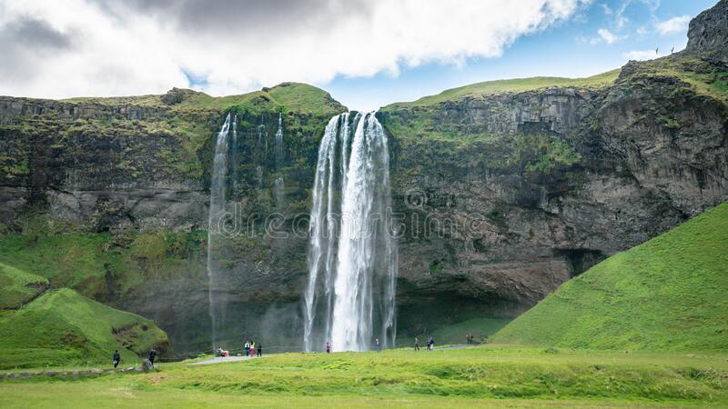 Gljufrabui waterfall with unidentifed tourists nearby in Iceland royalty free stock photography