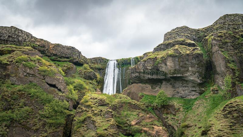 Gljufrabui waterfall with unidentifed tourists nearby in Iceland royalty free stock image