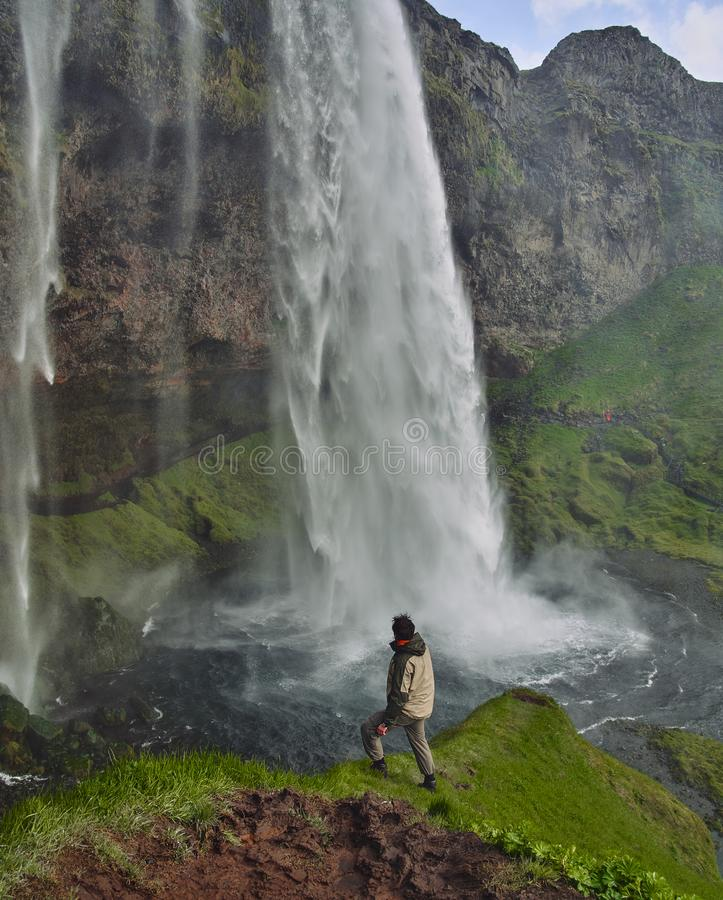 Gljufrafoss Gljufrabui waterfall in gorge of mountains. Tourist attraction Iceland near falls of Seljalandsfoss. Man royalty free stock image