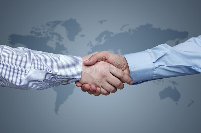 Global business. Business handshake with world map in the background stock photos