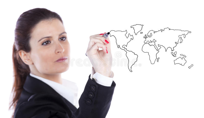 Global business concept. Businesswoman drawing the world map in a whiteboard (selective focus royalty free stock image